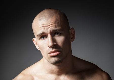 pitiful: portrait of pitiful strong man isolated on gray background