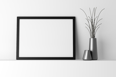 black and white frame: blank black photo frame on white shelf