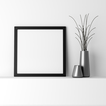 pictures: blank black photo frame on white shelf