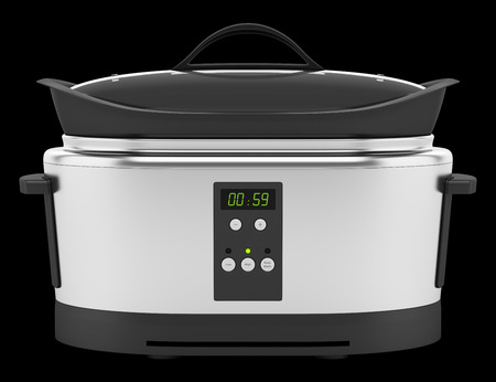 slow: slow cooker isolated on black background