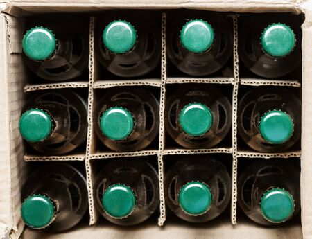 twelve: twelve beer bottles in cardboard box