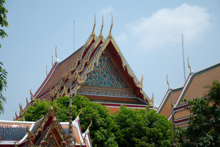 BANGKOK, THAILAND - CIRCA MARCH 2010: Thai architecture, view of the roofs of the vegetation in the Wat Pho complex (the Temple of the Reclining Buddha). Editorial use only.
