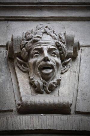 faun: bas-relief on the wall face of a Faun Stock Photo
