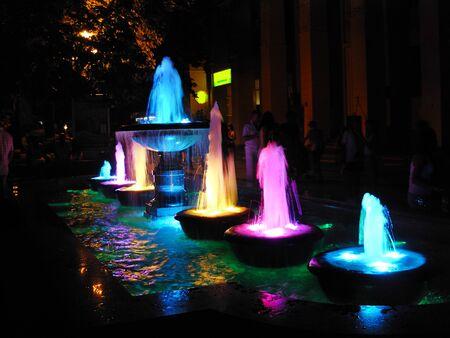 the night fountain with multi-colored illumination Фото со стока