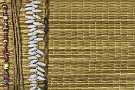 straw mat: straw mat background with shells and beads Stock Photo