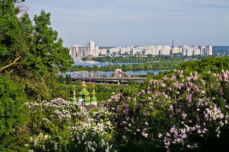 right bank: view from the park with blooming lilacs on the right bank of the Dnieper