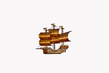 brig ship: wooden model sailboat on a white background