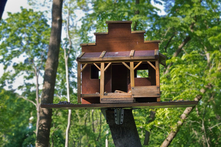 feeders: bird feeders in the form of a house closeup Stock Photo