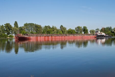 laden: laden barge, floating on a small river Stock Photo