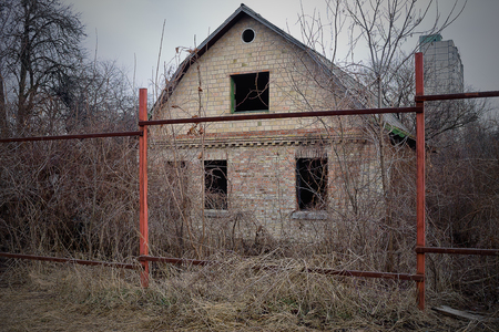 uninhabited: uninhabited small house with no windows in an abandoned site