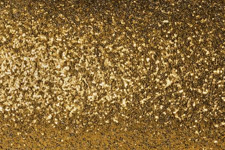 shiny gold: shiny  gold  background with sparkles closeup