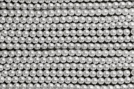 round brilliant: background string of  large gray pearls closeup