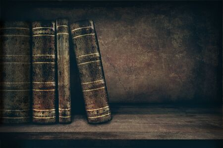 antique books: Vintage background with old books on a shelf and copy space