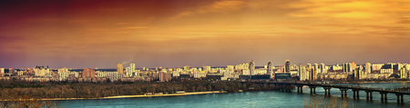 dnieper: Tinted evening cityscape of Kiev. Panorama of the left bank of the Dnieper.