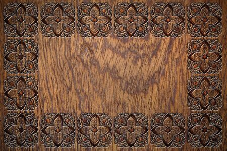 embossed: embossed floral frame on a wooden surface