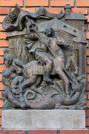 Mukachevo, Ukraine - July 21: a bas-relief on the wall closeup with the image of St. George slaying the dragon July 21, 2016 in Mukachevo, Ukraine