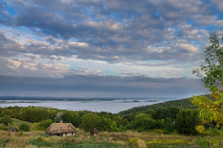 dnepr: landscape on the banks of the Dnieper with the ancient Ukrainian hut. The village Vitachev