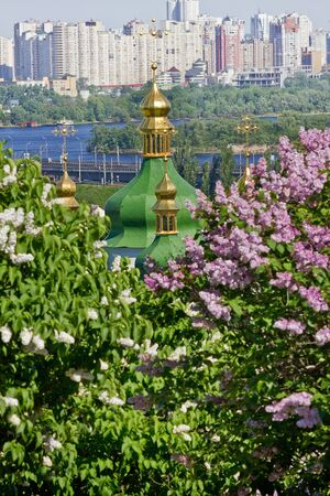 An ancient orthodox church among the blossoming lilacs.  Vydubetsky Monastery in Kiev, Ukraine