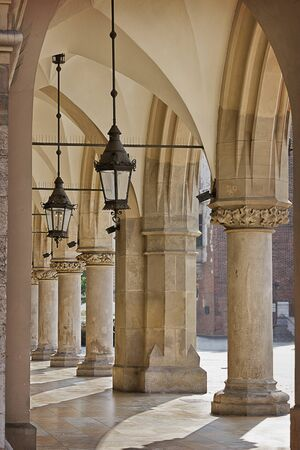Gallery with columns and lanterns.  Market building on the Market Square in Krakow, details.  Sights of Poland 版權商用圖片