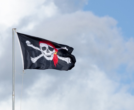 Detail of a flag showing a skull as a symbol for pirates  photo