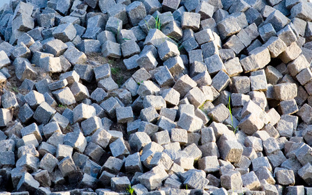 building material: Background  of a huge stock pile of granite and basalt stones and rocks used for building material.