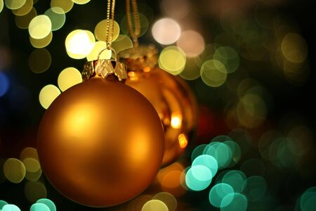 weihnachten: Christmas golden ball with a light blur creating bokeh in the background, natural zoom effect Stock Photo