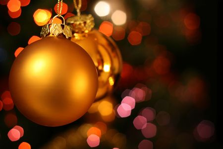 Christmas golden ball with a light blur creating bokeh in the background, natural zoom effect Stock Photo