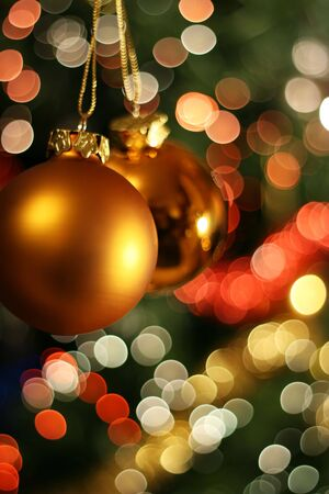 boules: Christmas golden ball with a light blur creating bokeh in the background, natural zoom effect Stock Photo