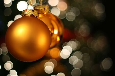 ecard: Christmas golden ball with a white light blur creating bokeh in the background Stock Photo