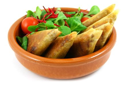 samosas and salad bowl, isolated on white