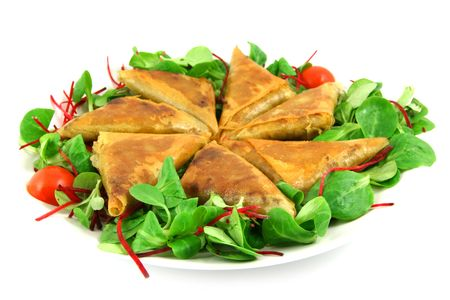 samosas and salad on a plate, isolated on white Stock Photo