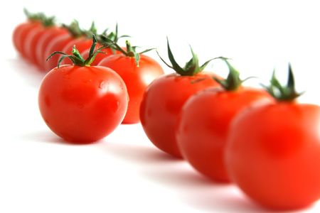 One step forward by one tomato, isolated on white