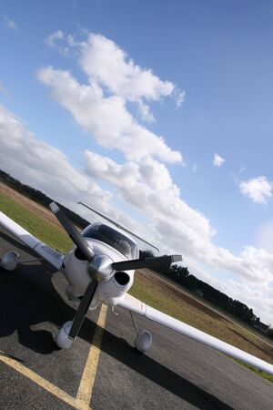 inclined: Inclined front view of a white plane on the runway