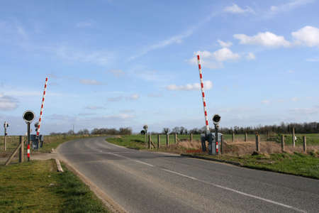 Railway level crossing in the country photo