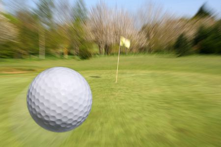 zooming: Golf ball flying to the cup. Zooming to the hole.