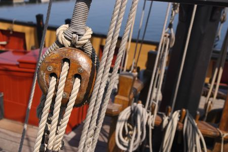 pulleys: Detail of a wooden sailing ship