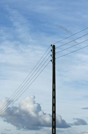 Power pole on a blue sky background Stock Photo - 1318983