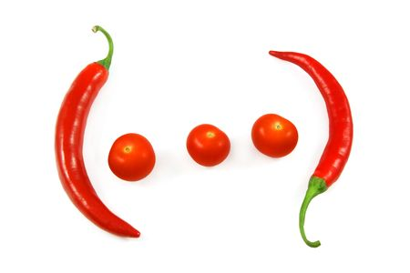 Red hot chili peppers and cherry tomatoes, isolated on white photo