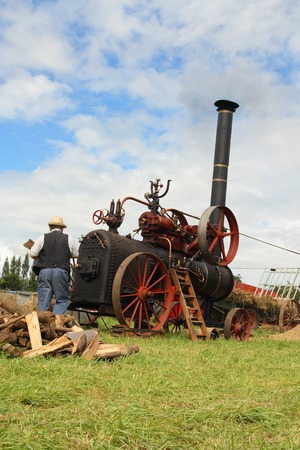 Vintage traction steam engine working in a field at the wheat fest photo