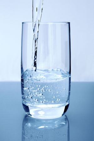 pour: Pouring pure water in a glass