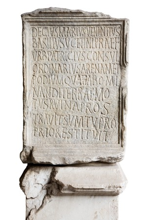 the romans: Engraved stone in Coliseum with latin letters Stock Photo