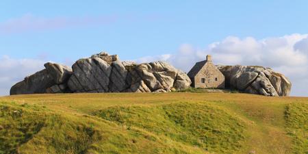 granit: Little house inside the rocks in Meneham village, Kerlouan, Brittany, France