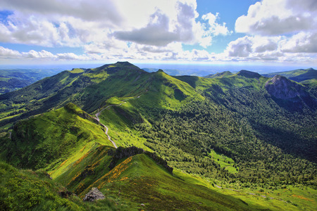 Panoramic landscape of volcanic mountains (view from Puy de Sancy, Massif Central, France)