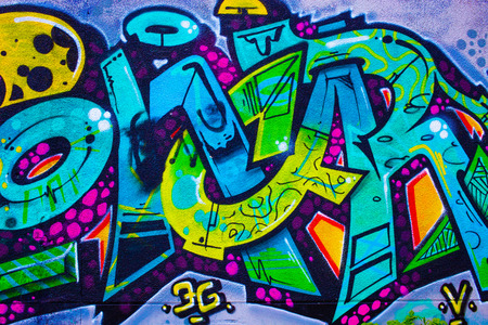 Detail of a colorful graffiti on a wall, abstract background