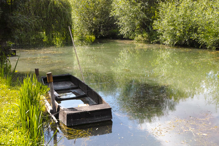 Small boat in marshes in Bourges, Berry province, Centre-Val de Loire, France