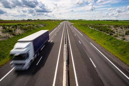 Motion blurred truck on the highway Reklamní fotografie