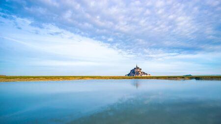 Mont-Saint-Michel and the bay at dawn in Normandy, France Stock Photo