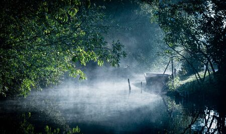 Mist on the river at dawn in the marshes of Bourges, Centre-Val de Loire, France