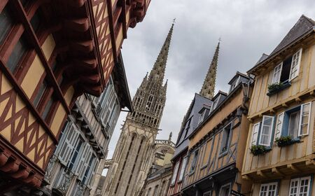 Street in Quimper with a view of the Cathedral of Saint Corentin, Brittany, France