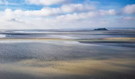 Scenic view on small Tombelaine tidal island from Le Mont Saint-Michel in Normandy